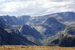 A view from the summit of the Beartooth pass. It's breathtaking. Note the secondary road at the bottom of the valley, really puts the altitude into perspective. This is really high and absolutely stunning views.